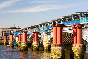 Blackfriars Bridge across the River Thames in London, UK, is the world's largest solar bridge. Its parapet contains over 4400 solar photo voltaic panels, generating 50% of the stations electricity nee... - Ashley Cooper
