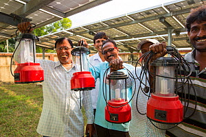 Man with new solar lanterns from  WWF project to supply electricity to a remote island in the Sunderbans, Ganges Delta, India. December 2013  -  Ashley Cooper