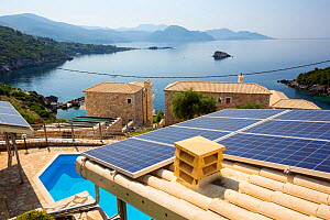 Solar panels on a house roof in Sivota, Greece. June 2014 - Ashley Cooper
