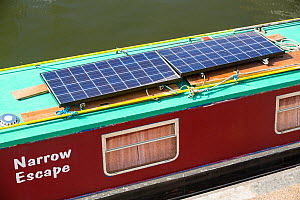 Solar panels on a canal boat behind Kings Cross, London, UK. June 2014 - Ashley Cooper