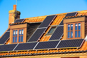 Solar panels on a house in Cley on the North Norfolk coast, UK. October 2014 - Ashley Cooper