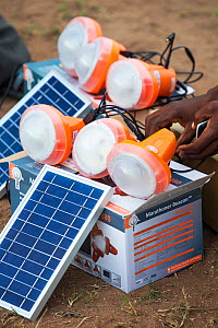 Solar lamps charging by solar panels, in the refugee camp of Chiteskesa refugee camp, near Mulanje. March 2015 - Ashley Cooper