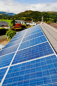 Solar voltaic panels on a house roof in Ambleside, Cumbria, UK. September 2011 - Ashley Cooper