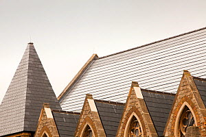 Solar tiles on St Silas's church in Pentonville, London, UK. This new solar roof, produces aprox. 47% of the buildings energy needs and will reduce C02 emissions by 7,000 kg per year. October 2010 - Ashley Cooper