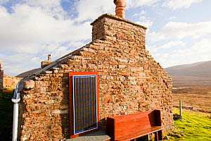 An old croft house with a solar panel at Rackwick on the isle of Hoy, Orkney, Scotland, UK. October 2011 - Ashley Cooper