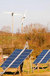 Solar panels and wind turbines on a farm near Woodhouse Eaves in Leicestershire, UK. March 2012 - Ashley Cooper