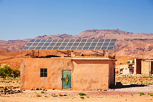 Solar panels on a house roof in a Berber village in the Anti Atlas mountains of Morocco, North Africa. April 2012 - Ashley Cooper