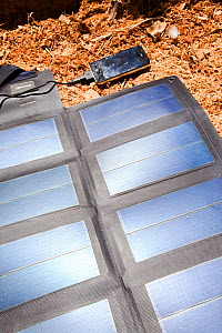A portable solar mat used fro recharging a mobile phone in the Anti Atlas mountains of Morocco, North Africa. April 2012 - Ashley Cooper