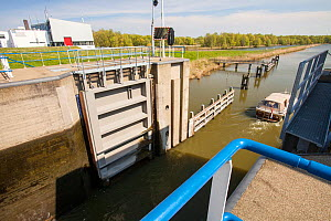 Canal going from the sea to the reclaimed polder land in Holland, north of Amsterdam, which is some 20 feet lower than the sea. With 50% of the Netherlands below sea level, it is incredibly vulnerable... - Ashley Cooper