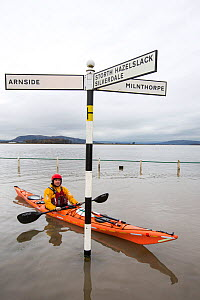 Kayakers in the flood waters on the road at Storth, Kent Estuary in Cumbria, UK, during the January 2014 storm surge and high tides. January 2014 - Ashley Cooper