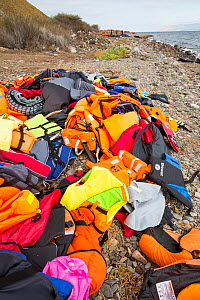 Life jackets and remains of boats left by Syrian migrants, refugees fleeing the war. Lesvos Island, Efthalou, Greece. September. - Ashley Cooper