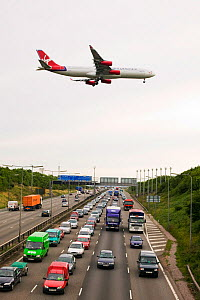 Traffic congestion on the M1 motorway at Loughborough,  with a plane coming into land at East Midlands Airport. August 2005 - Ashley Cooper