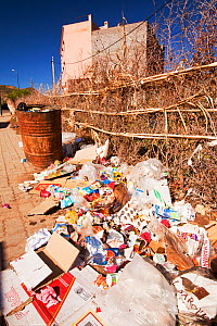 Rubbish on the streets of a town in the Atlas mountains, Morocco, North Africa. April 2012 - Ashley Cooper