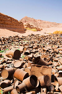 Tin cans discarded in the mountains of the Sinai desert near Dahab, Egypt. October 2008  -  Ashley Cooper