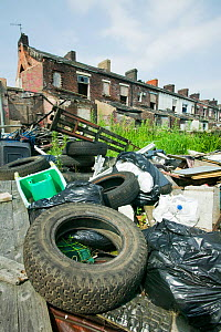Illegal fly tipping in a rundown area of Blackburn, England, UK. June 2006  -  Ashley Cooper