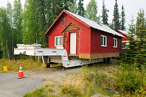 House in Fairbanks Alaska moved after it started collapsing into the ground due to global warming induced permafrost melt. August 2004  -  Ashley Cooper