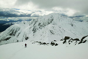 Winter climber ascends An Garbhanach in the Mamore hills, Scotland, UK.  March 2004 - Ashley Cooper