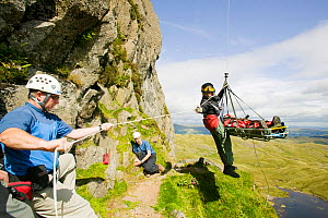Injured climber with a dislocated shoulder is winched off Jacks Rake Pavey Ark by the Langdale Ambleside Mountain Rescue Team, Lake District, England, UK, August. August 2005  -  Ashley Cooper