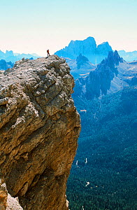 A mountaineer on a summit in the Italian Dolomites. Italy. - Ashley Cooper
