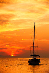 Sailing boat at sunset in front of Corfu, from Sivota, Greece. June 2014 - Ashley Cooper