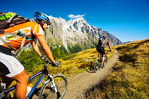Mountain bikers on Mont de la Saxe above Courmayeu, Italy. August 2014  -  Ashley Cooper