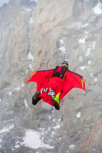 Base jumpers wearing wing suites jumping from the Aiguille Du midi above Chamonix, France. September 2014  -  Ashley Cooper
