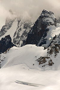Mont Blanc Du Tacul,  with mountaineers crossing the Vallee Blanche.  Aiguille Du midi, above Chamonix, France, September 2014  -  Ashley Cooper