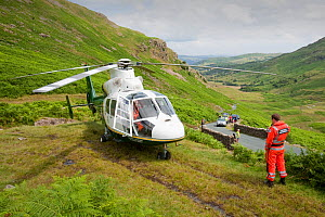 Paramedics from the Great north Air Ambulance and members of Langdale/Ambleside Mountain Rescue  evacuate an injured man who fell into Wrynose Beck. England, UK. July 2009 - Ashley Cooper