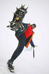 Low angle view of climber with crampons on boot, Aonach Mhor, Scotland, UK.  March 2004  -  Ashley Cooper