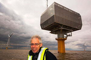 Doug Parr, chief scientist for Greenpeace UK, at Gunfleet Sands offshore wind farm which  is owned and operated by Dong energy. Brightling Sea, Essex, UK. September 2015  -  Ashley Cooper