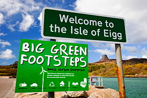 Big green Footsteps sign on Eigg Harbour, Scotland, UK. May 2012 - Ashley Cooper