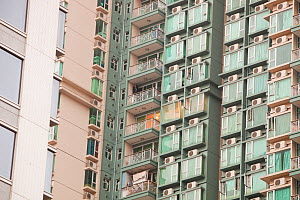 Flats in Kowloon with air conditioning units. Hong Kong, February 2010.  -  Ashley Cooper