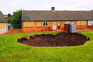 Sinkhole  in a back garden in Egremont Cumbria as a result of mining subsidence when an old mine shaft opened up, England, UK. June 2005  -  Ashley Cooper