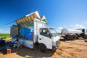 Specialist truck that takes water straight from the river and purifies it to drinking standards. In refugee camps for people displaced by the January 2015 flooding, Shire valley, Malawi. March 2015. - Ashley Cooper