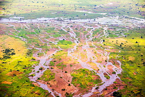 Aerial view of flooded farmland around Makhanga, which two months after the January 2015 floods, is still cut off after rail and road connections which were washed away. Malawi, March 2015. - Ashley Cooper