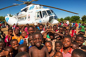 Russian Mi8 helicopter being used by the United Nations, World Food Program to deliver food aid to areas still cut off by the flooding, around Bangula and Mkhanga. Malawi, March 2015. - Ashley Cooper