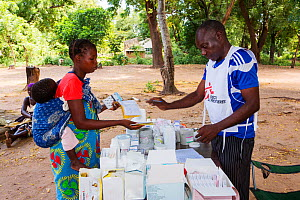 Medecins sans Frontieres  clinic in Makhanga testing local people, many of whom now have malaria. A result of the January 2015 floods, the drying up flood waters provided an ideal breeding grounds for... - Ashley Cooper