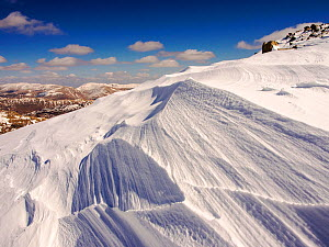 Snow shaped by a strong wind, above Wrynose Pass in the Lake District, Cumbria, UK. April 2013.  -  Ashley Cooper