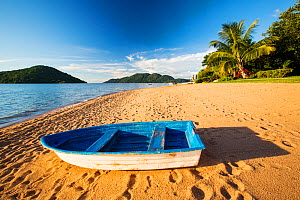 Boat on a beach at Cape Maclear, Lake Malawi, Malawi, Africa. March. - Ashley Cooper