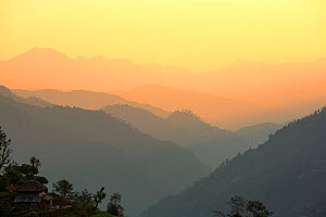 Misty light over the Modi Khola valley below the Annapurna Sanctuary, Himalayas, Nepal. December 2012. - Ashley Cooper