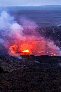 Lava glowing in the Halema'uma'u Crater viewed from the Jaggar Museum in Volcanoes National Park, Hawaii. December 2016. - Kirkendall-Spring