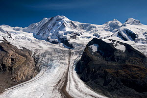 The Gorner Glacier with the Briethorn in cloud, Valais, Switzerland. September 2017. The glacier has a medial moraine running along its centre, formed when two glaciers with lateral moraines merge. - Graham Eaton