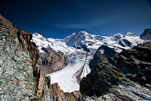 The Gorner Glacier with the peaks of The Briethorn, Western Lyskamm, Castor and Pollux . Switzerland. September 2017. The Gornerglacier has a medial moraine running along its centre, formed when two l... - Graham Eaton