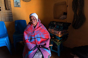 Local woman wrapped in traditional Basotho blanket in her home in Semonkong, Lesotho. August 2017 - Rhonda Klevansky