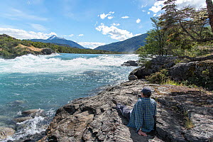 Man looking out over Baker River, Patagonia, Chile, January 2017. - Rhonda Klevansky