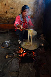 Chinese woman cooking, Xiang Bai Lisu village, Tongbiguan Nature Reserve, Dehong prefecture, Yunnan province, China. May - Staffan Widstrand / Wild Wonders of China