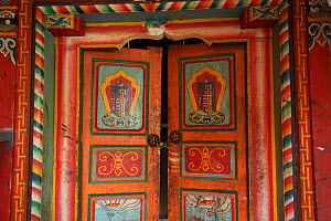 Decorated door entrance to a building at Lower Yubeng village, Meili Snow Mountain National park, Yunnan, China, October 2017.  -  Staffan Widstrand / Wild Wonders of China