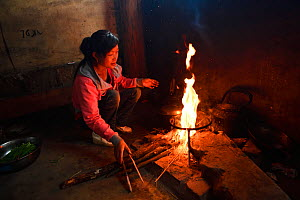Woman cooking,  Xiang Bai Lisu village, Tongbiguan Nature Reserve, Dehong prefecture, Yunnan province, China, May. - Staffan Widstrand / Wild Wonders of China