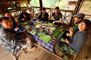 Lunch served on banana leaves, at the ranger station, Tongbiguan Nature Reserve, Dehong prefecture, Yunnan province, China. May - Staffan Widstrand / Wild Wonders of China