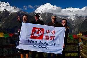 Wild Wonders of China team in front of Bawu Bameng, 6000 m, along the pilgrimage route around Meili Snow Mountain, 6740 m, a Sacred mountain for Tibetan Buddhists, Yunnan, China, October 2017.  -  Staffan Widstrand / Wild Wonders of China